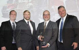 Elgin Industries President William Skok, second from right, receives the Navistar Diamond Supplier Award during a recent ceremony. Elgin has won the award, Navistar's top honor for suppliers, twice since 2010.