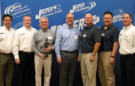 """Elgin Industries President Bill Skok, center, and National Sales and Marketing Director Rick Simko, third from right, receive """"ELMO"""" award"""