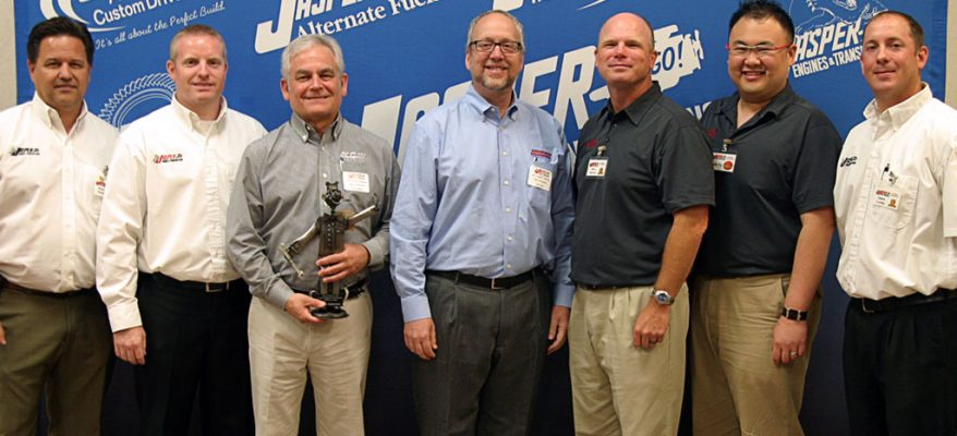 "Elgin Industries President Bill Skok, center, and National Sales and Marketing Director Rick Simko, third from right, receive ""ELMO"" award"