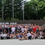 Large group photo in front of the building from Elgin Industries 100th Anniversary Summer Celebration.